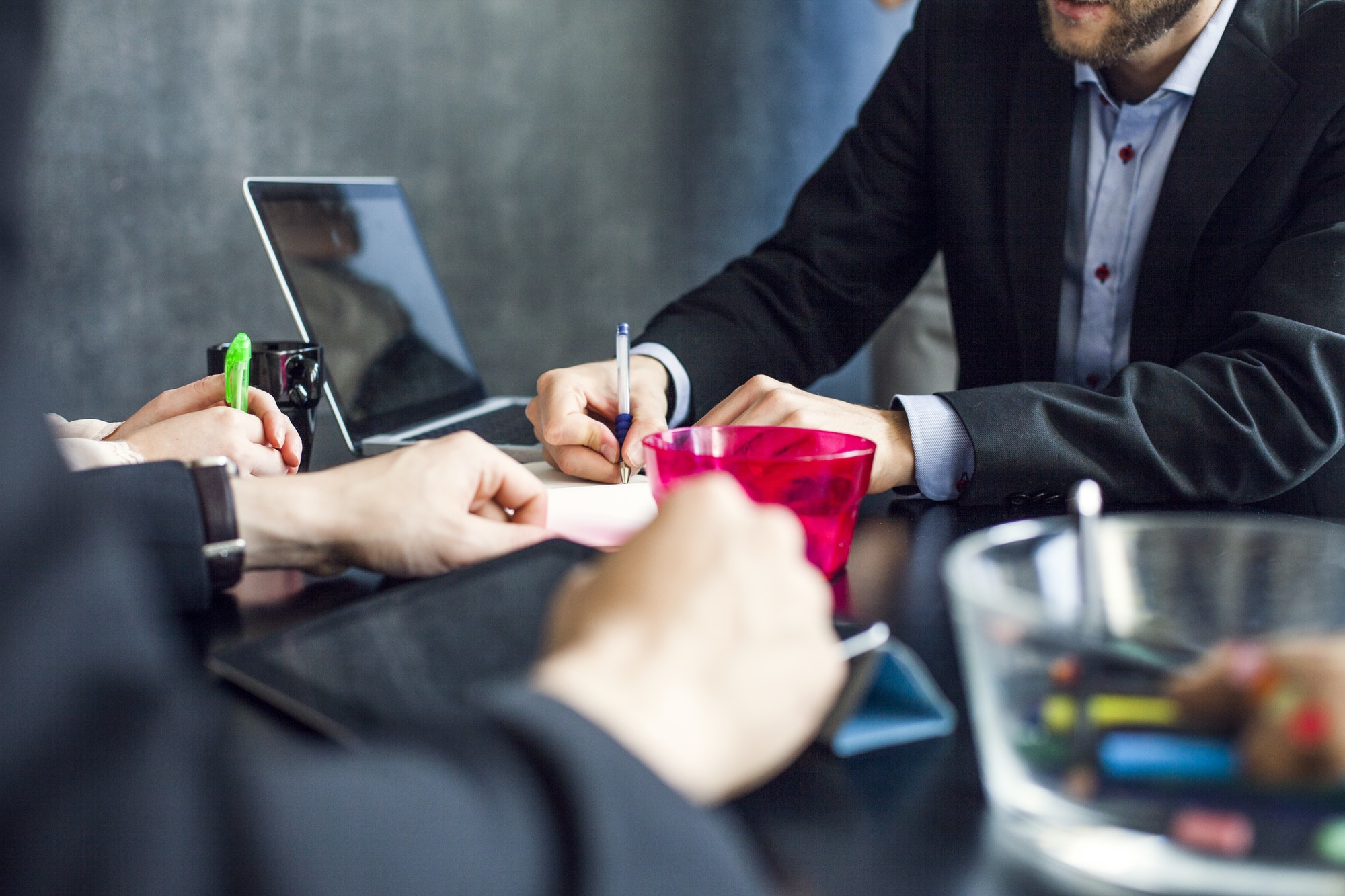 Cropped image of business people working at desk in creative office